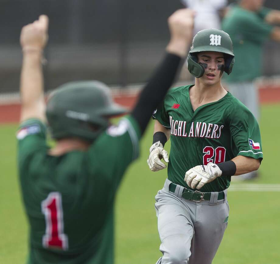 Cameron Caley #20 of The Woodlands scores on an two-run double by Casey Sunseri in the third inning of Game 1 during a Region II-6A area high school baseball playoff series at Grand Oaks High School, Thursday, May 9, 2019, in Spring. Photo: Jason Fochtman, Staff Photographer