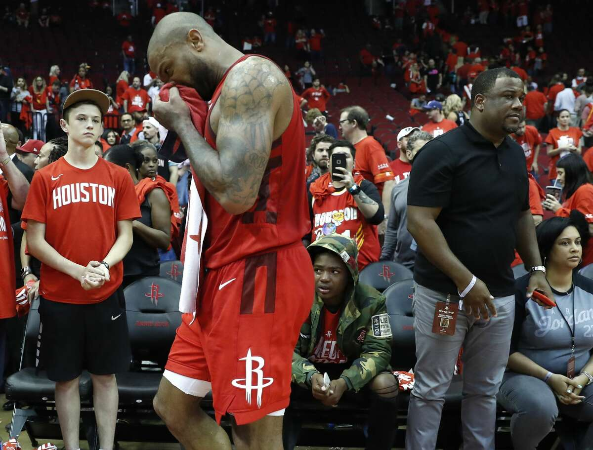 Rockets forward P.J. Tucker (17) walks off the court at the end of Game 6 of the NBA Western Conference semifinals at Toyota Center on Friday. The Warriors eliminated the Rockets with a 118-113 win, to take the series 4-2.