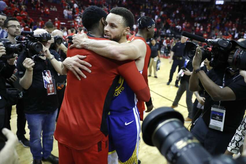 Golden State Warriors guard Stephen Curry (30) hugs Houston Rockets guard Iman Shumpert at the end of Game 6 of the NBA Western Conference semifinals at Toyota Center on Friday, May 10, 2019, in Houston. The Warriors eliminated the Rockets with a 118-113 win, to take the series 4-2.