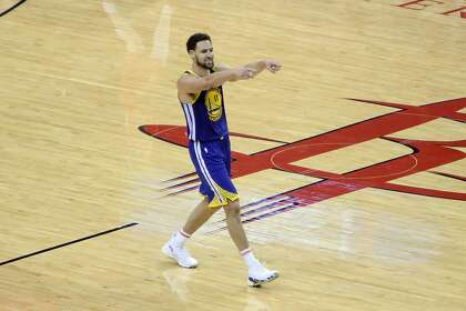 2b6dde4bdfb Golden State Warriors guard Klay Thompson reacts after a made three pointer  in the fourth quarter of Game 6 of the Western Conference Semifinals  against the ...