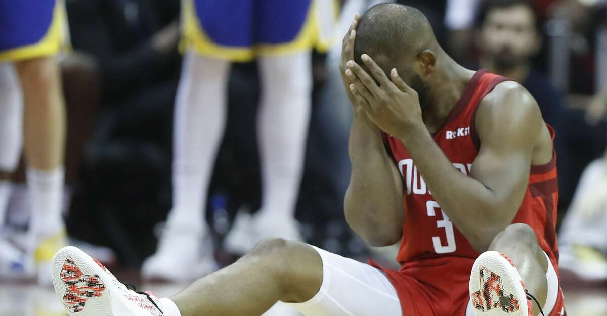 Houston Rockets guard Chris Paul (3) holds his face as he sits on the floor during the second half of Game 6 of the NBA Western Conference semifinals against the Golden State Warriors at Toyota Center on Friday, May 10, 2019, in Houston.