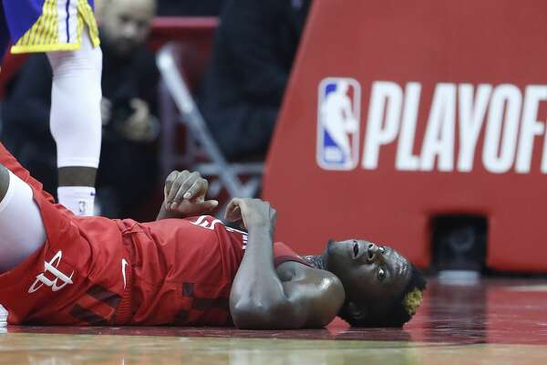 Houston Rockets center Clint Capela (15) lies on the court after he was undercut in the lane during the second half of Game 6 of the NBA Western Conference semifinals against the Golden State Warriors at Toyota Center on Friday, May 10, 2019, in Houston.
