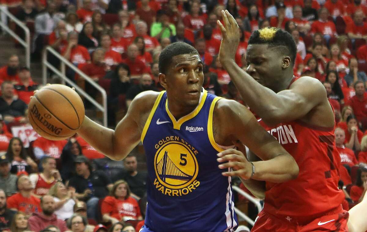 Golden State Warriors forward Kevon Looney drives to the basket against center Clint Capela in the 3rd quarter during Game 6 in the Western Conference Semifinals against the Houston Rockets at Toyota Center in Houston, TX on Friday May 10, 2019.