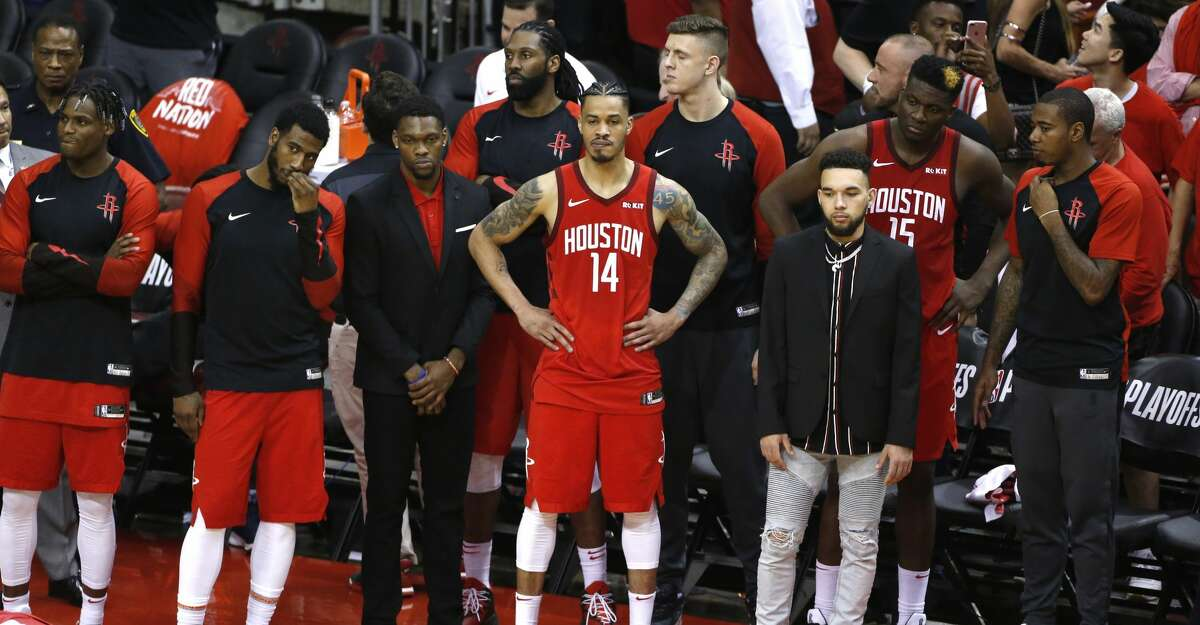 The Rockets bench stands and watches as time runs out in the second half of Game 6 of the NBA Western Conference semifinals at Toyota Center on Friday, May 10, 2019, in Houston. The Warriors eliminated the Rockets with a 118-113 win, to take the series 4-2.