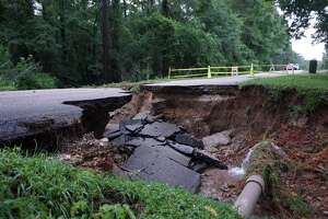 The sinkhole at the 1600 block of Hamblen Road near Redbud Lane on May 8 in Kingwood.