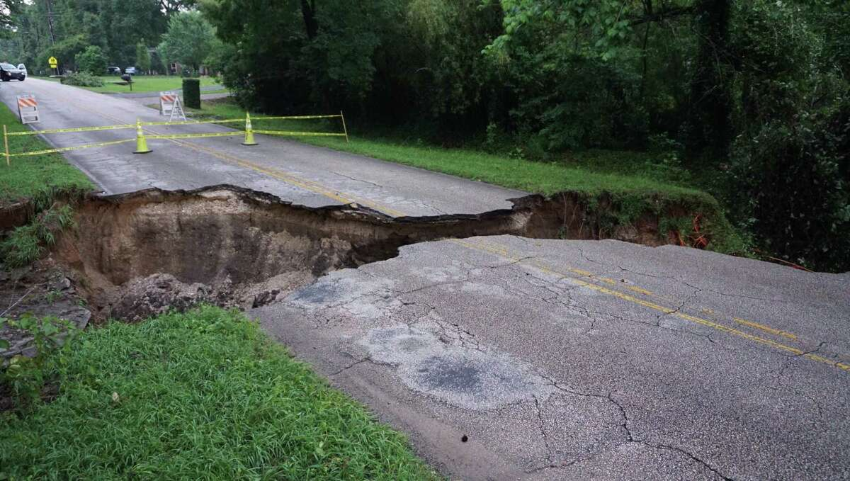 A sinkhole opened in the 1600 block of Hamblen Road near Redbud Lane in Kingwood during storms on May 8.