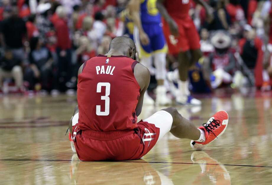 Houston Rockets guard Chris Paul sits on the court following a play during the second half in Game 6 of the team's second-round NBA basketball playoff series against the Golden State Warriors, Friday, May 10, 2019, in Houston. Golden State won 118-113, winning the series. (AP Photo/Eric Gay) Photo: Eric Gay, STF / Associated Press / Copyright 2019 The Associated Press. All rights reserved.