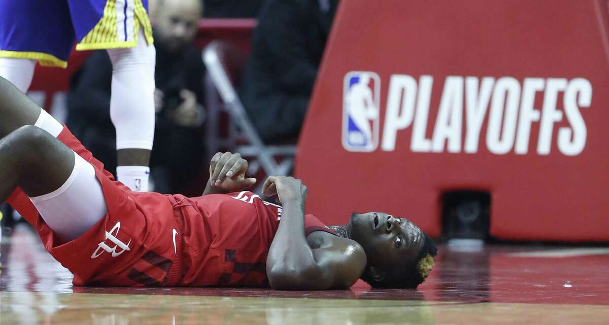 Rockets center Clint Capela finds the court at Toyota Center a good place to rest after he being undercut by a Warrior defender during a battle under the boards.