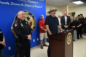 Harris County Precinct 4 Constable Mark Herman, from left, and Commissioner Jack Cagle lead the ribbon cutting for the new Pct. 4 substation in Spring on May 10, 2019.