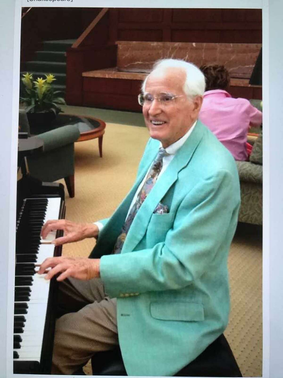 """Pianist Joe """"Butch"""" DeLuca playing The American Songbook at Greenwich Hospital's atrium."""