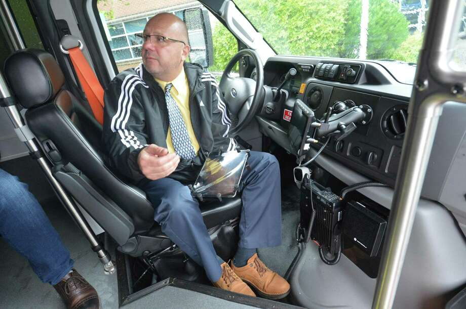The Norwalk Transit District introduces its new MicroTransit buses Wheels2U as Transit District Chief Operating Officer Britt Liotta opens the App in a tablet to guide the driver where the pick up would be. The buses were shown at the Norwalk Transit District headquarters on Monday September 10, 2018 in Norwalk Conn. Photo: Alex Von Kleydorff / Hearst Connecticut Media / Norwalk Hour