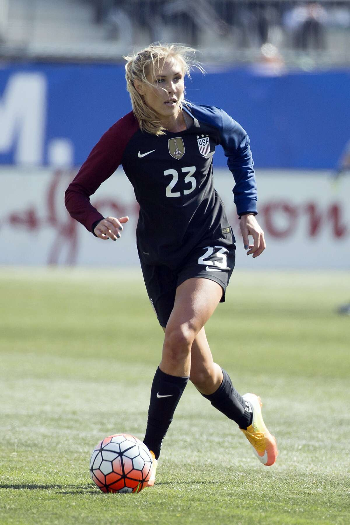 FILE - In this April 10, 2016, file photo, United States' Allie Long (23) dribbles the ball during the second half of an international friendly soccer match against Colombia in Chester, Pa. Long is among 23 players named to the team that was getting in its last three exhibition games this month before heading to Europe for the Women's World Cup, which opens June 7. (AP Photo/Chris Szagola, File)