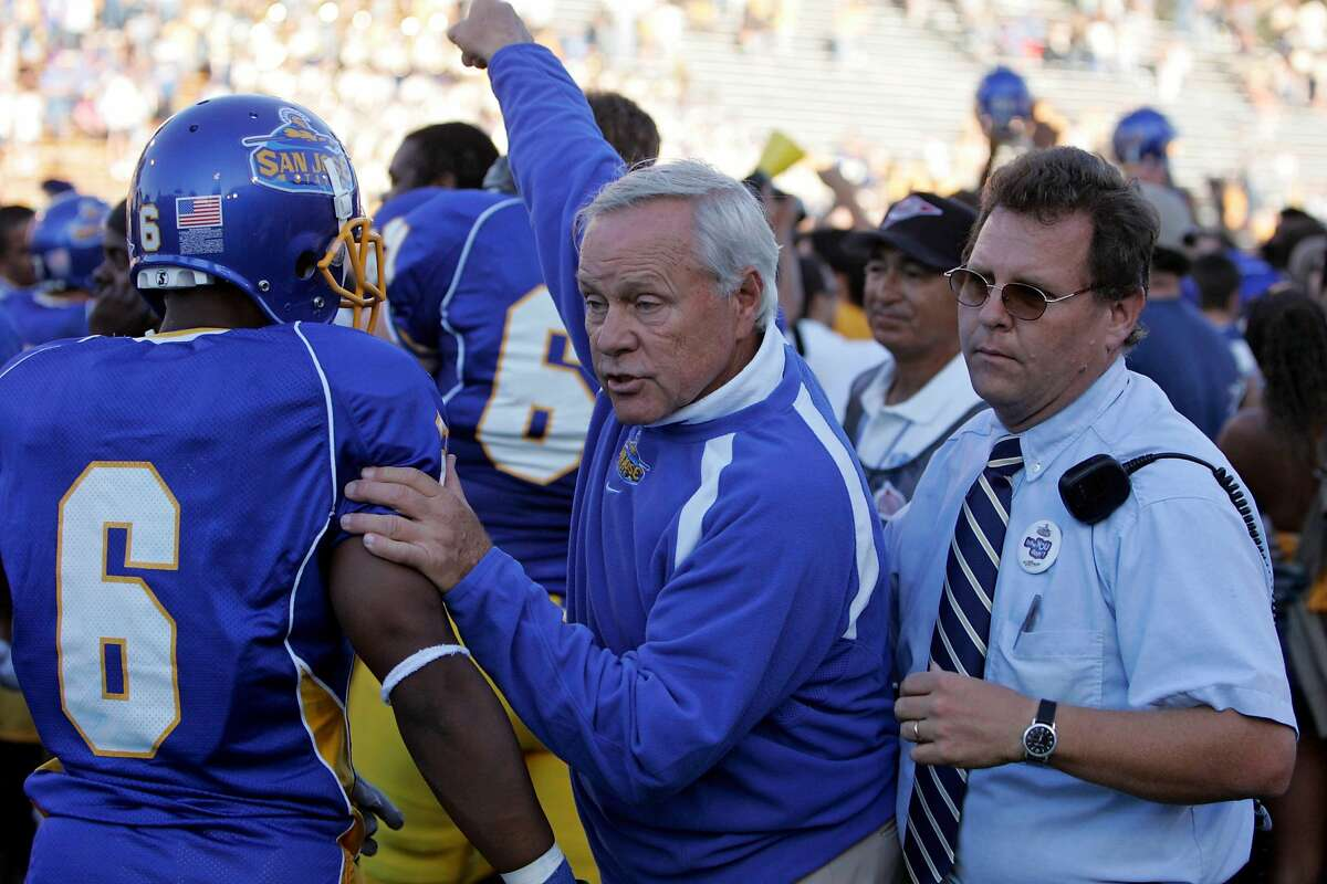 San Jose State's Head coach Dick Tomey trys to get off the field after the end where SJ beat Stanford 35-34. Stanford Vs San Jose State at Spartan stadium. KURT ROGERS /THE CHRONICLE SAN JOSE THE CHRONICLE SFC STANFORD_0624_kr.jpg Ran on: 11-10-2006 Dick Tomey says an SJSU win wouldnt be an upset. Ran on: 11-10-2006 Ran on: 12-08-2006 San Jose State coach Dick Tomey was rewarded for his 8-4 season with a 2-year extension. Ran on: 12-08-2006 ALSO Ran on: 08-30-2007 Coach Dick Tomey has improved his teams defense; the Spartans allowed 42.6 points a game in 2004 and 20.8 per game last year. Ran on: 08-30-2007