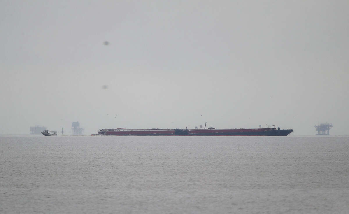 A barge involved in a collision with the tanker ship Genesis River the day before remains in the Houston Ship Channel on Saturday, May 11, 2019, in Pasadena.