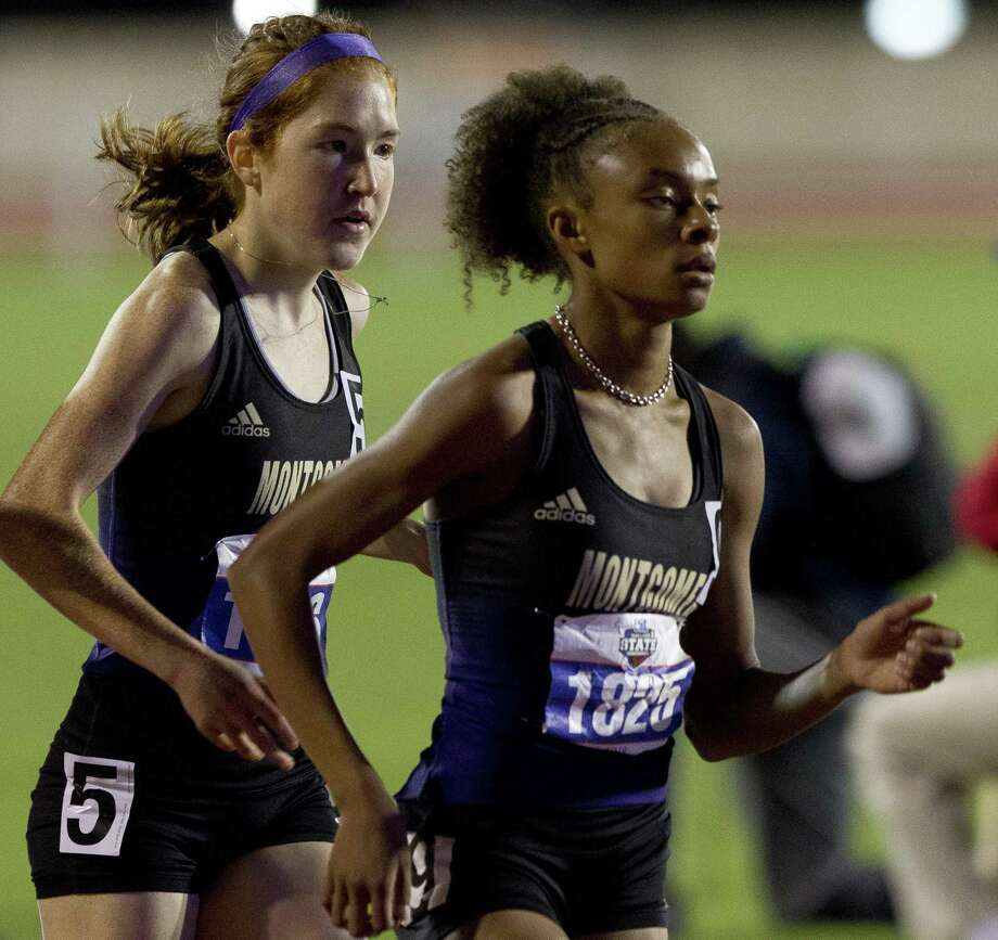 Montgomery's Halena Rahmaan runs beside teammate Allison Wilson in the 5A girls 1600-meter run during the UIL State Track & Field Championships at Mike A. Myers Stadium, Friday, May, 10, 2019, in Austin. Marshall finished first in the event. Photo: Jason Fochtman, Houston Chronicle / Staff Photographer / © 2019 Houston Chronicle