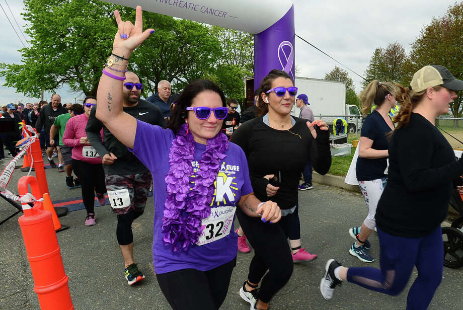 Daughter of Donna Cutrone, Gina Franco, leads the The Project Purple Steps for a Cure run and walk to benefit Pancreatic Cancer research Saturday, May 11, 2019, at Calf Pasture Beach in Norwalk, Conn.  The event is in memory of lifelong Norwalk resident Donna Cutrone and all those battling pancreatic cancer. Photo: Erik Trautmann, Hearst Connecticut Media / Norwalk Hour