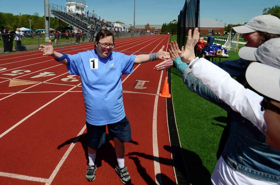 Karen Chamberlin of West Haven competes inThe Special Olympics Connecticut 2019 Southern Time Trials Saturday, May 11, 2019, at Weston High School in Weston, Conn. The annual event gives athletes of all abilities from the region opportunities to compete in Track & Field, Swimming and Tennis. Special Olympics Connecticut provides year-round sports training and competitions for over 12,000 athletes of all ages with intellectual disabilities Photo: Erik Trautmann, Hearst Connecticut Media / Norwalk Hour