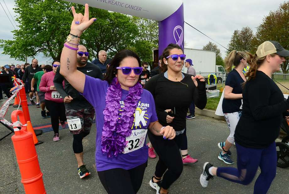 Daughter of Donna Cutrone, Gina Franco, leads the The Project Purple Steps for a Cure run and walk to benefit Pancreatic Cancer research Saturday, May 11, 2019, at Calf Pasture Beach in Norwalk, Conn. The event is in memory of lifelong Norwalk resident Donna Cutrone and all those battling pancreatic cancer. Photo: Erik Trautmann / Hearst Connecticut Media / Norwalk Hour