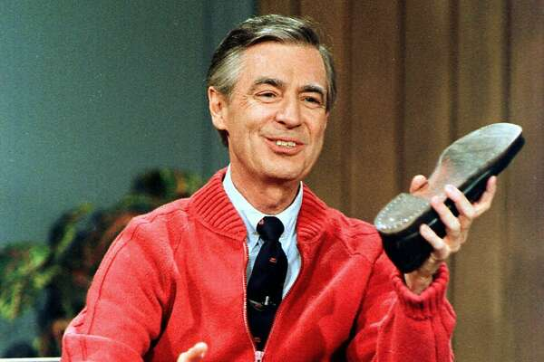 "FILE - This June 28, 1989 file photo shows Fred Rogers as he rehearses the opening of his PBS show ""Mister Rogers' Neighborhood"" during a taping in Pittsburgh. Pennsylvania Gov. Tom Wolf said on Friday, May 10, 2019, that Pennsylvanians will be encouraged to exhibit acts of kindness later this month in honor of the beloved PBS children's show host. (AP Photo/Gene J. Puskar, File)"