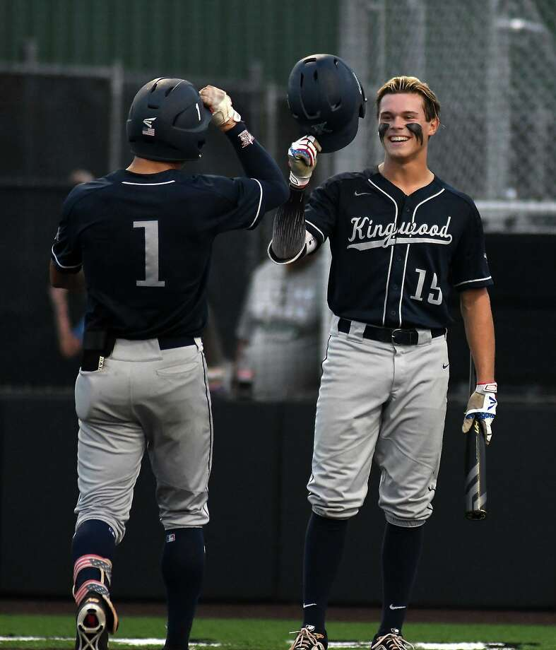 Kingwood leftfielder Luke Johnson (15) greets teammate Masyn Winn (1) at home plate after Winn's homerun in the bottom of the third inning against Clear Falls in Game One of their best of three series at Humble High School on May 10, 2019. (Photo by Jerry Baker) Photo: Jerry Baker, Houston Chronicle / Contributor / Houston Chronicle