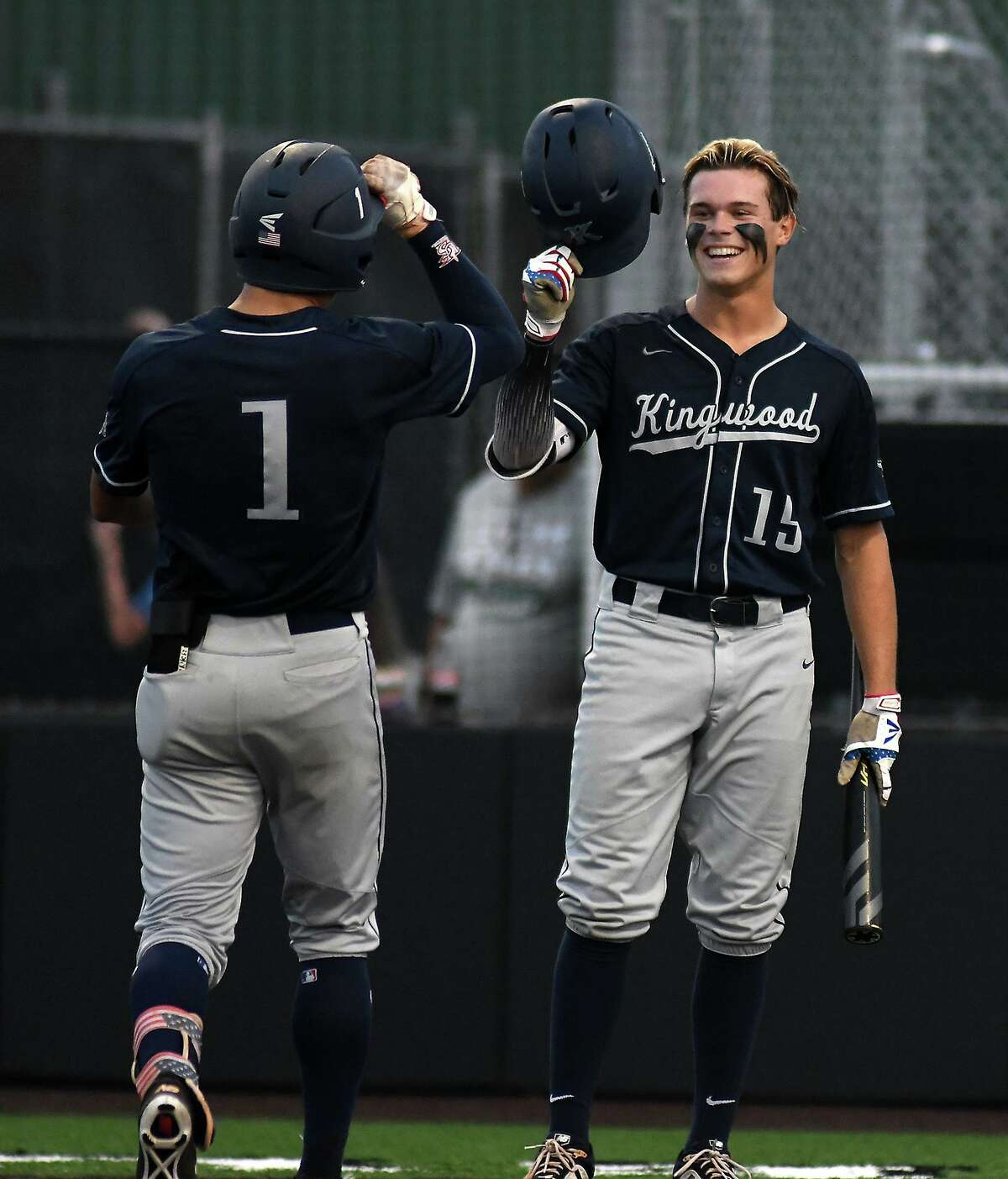 Kingwood leftfielder Luke Johnson (15) greets teammate Masyn Winn (1) at home plate after Winn's homerun in the bottom of the third inning against Clear Falls in Game One of their best of three series at Humble High School on May 10, 2019. (Photo by Jerry Baker)