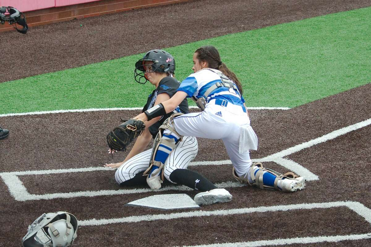 Friendswood's Patricia Yarotsky (6) slides to beat the tag from Barbers Hill's Estela Garza (1) Saturday, May 11 at Crosby High School.