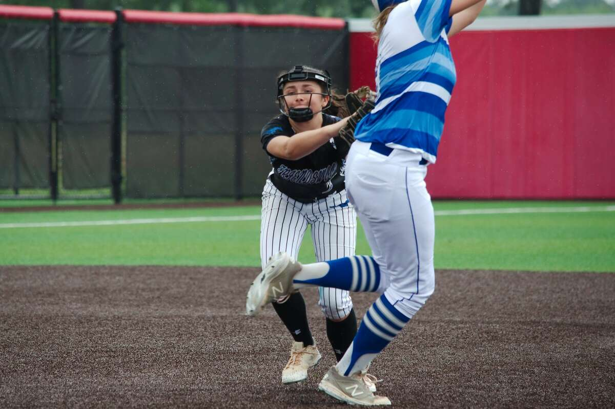 Friendswood's Madelyn Wilson (3) makes the tag on Barbers Hill's Sydney Hoyt (9) Saturday, May 11 at Crosby High School.