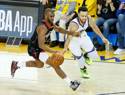 0fb9c68cf09 Golden State Warriors Stephen Curry defends against Houston Rockets Chris  Paul in the third quarter during game 5 of the Western Conference  Semifinals ...