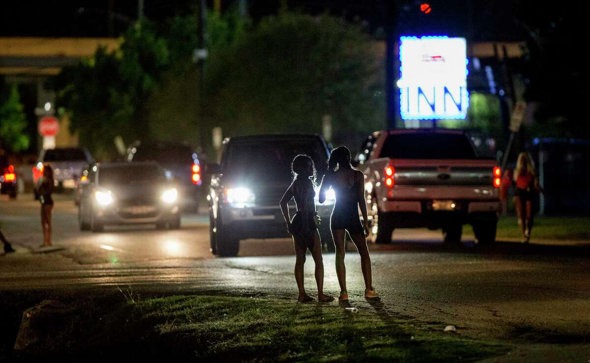 Women stand at Ponderosa Lane and Plainfield Street in a Houston area known as the Bissonnet Track, which is a notorious hot spot for sex trafficking and prostitution, Thursday, Sept. 6, 2018.