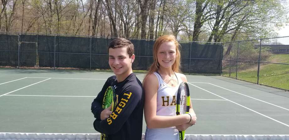 Rob Israel, left, and Sam Riordan are the No. 1 singles players for the Hand boys and girls tennis teams. Neither team has lost a regular-season match since May of 2016. Photo: Joe Morelli / Hearst Connecticut Media