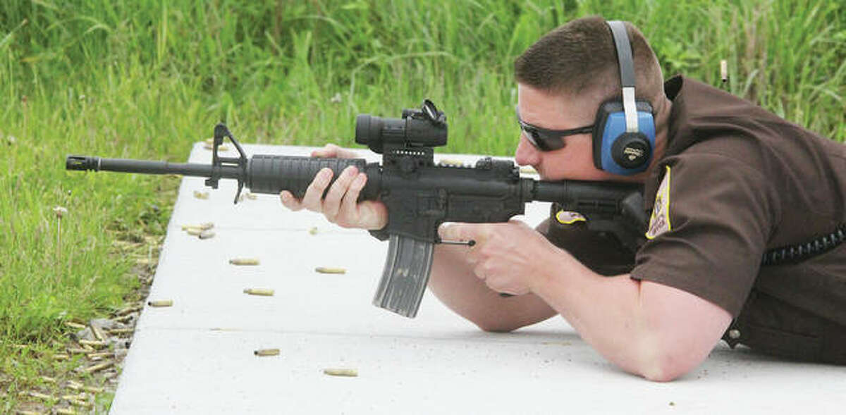 Madison County Sheriff's Deputy Ben Patterson fires an AR-15 at the departments firing range while qualifying with his duty weapons Thursday. The departments officers are all going through qualifications, which occur twice each year. The range, located on part of an old Nike Missile base in Marine, is undergoing a number of improvements.