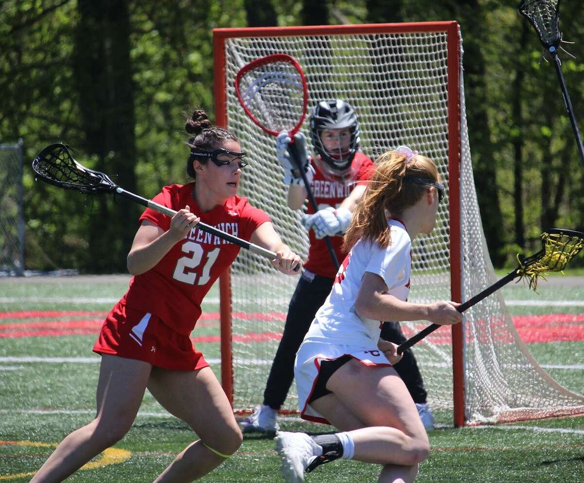 Greenwich's Olivia Hoekman defends against host New Cannan on Saturday.