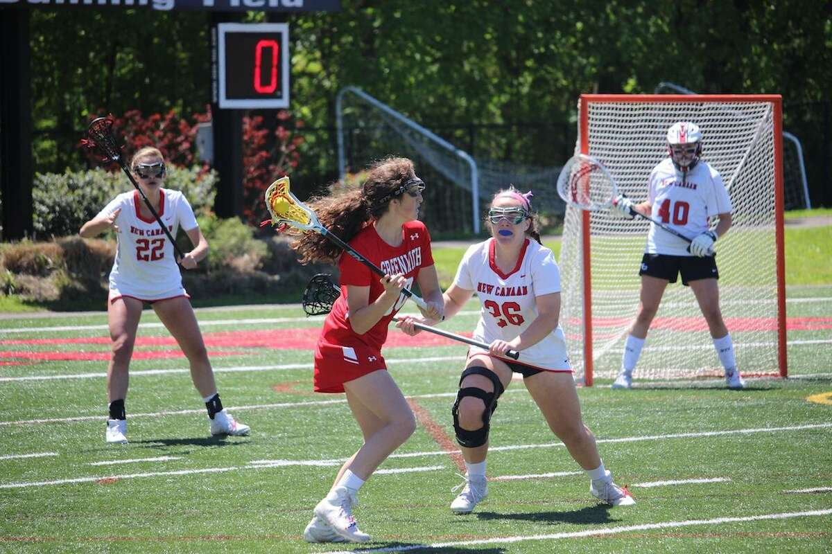 New Canaan's Nora Belodeau defends against visiting Greenwich on Saturday.