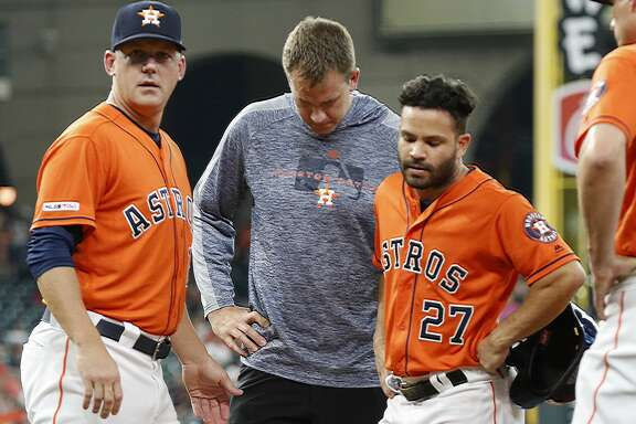Houston Astros second baseman Jose Altuve (27) leaves the game in the 1st inning after getting to first base during an MLB baseball game at Minute Maid Park Friday, May 10, 2019, in Houston.
