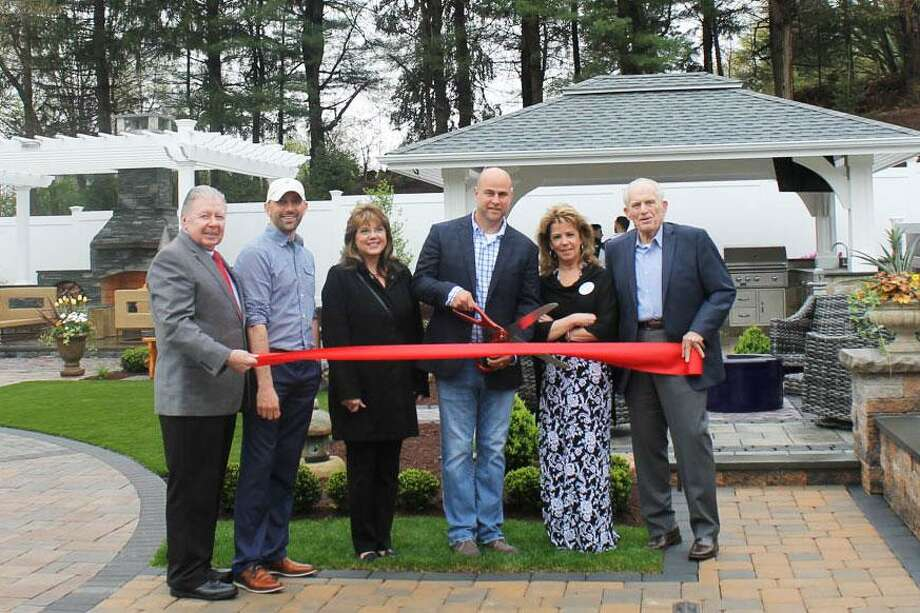 Torrison Stone & Garden at 422 Main St., Durham, held a ribbon cutting for its new outdoor showroom April 26. From left are Middlesex County Chamber of Commerce Chairman Jay Polke, Torrison Landscape Architect & Managing Partner Brian Murphy, First Selectman Laura Francis, Torrison Owner Tyler Gerry, Business Manager Suzanne Ciofalo and Chamber President Larry McHugh. Photo: Contributed Photo