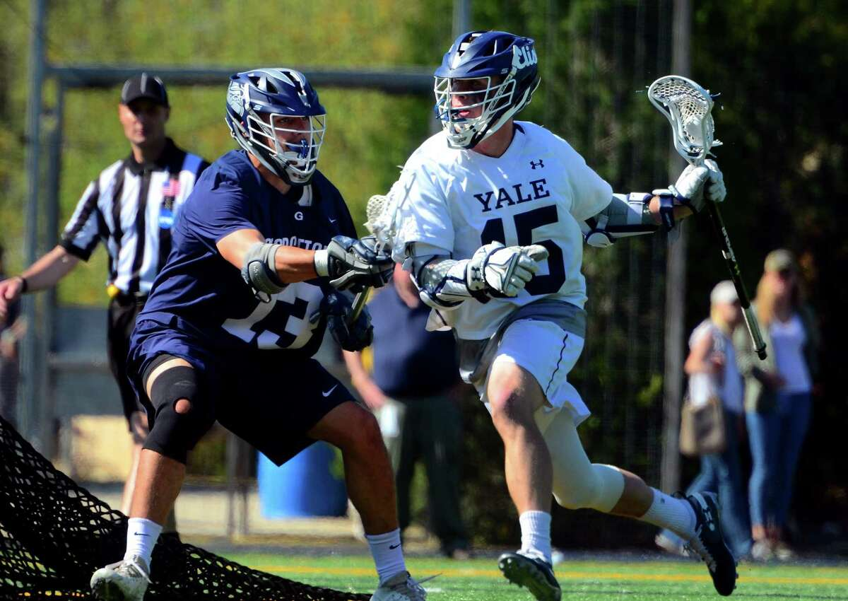 Yale's Jackson Morrill (15) drives the ball behind the goal as Georgetown's Zachary Geddes defends during the first round of the NCAA Division I tournament in May in New Haven.