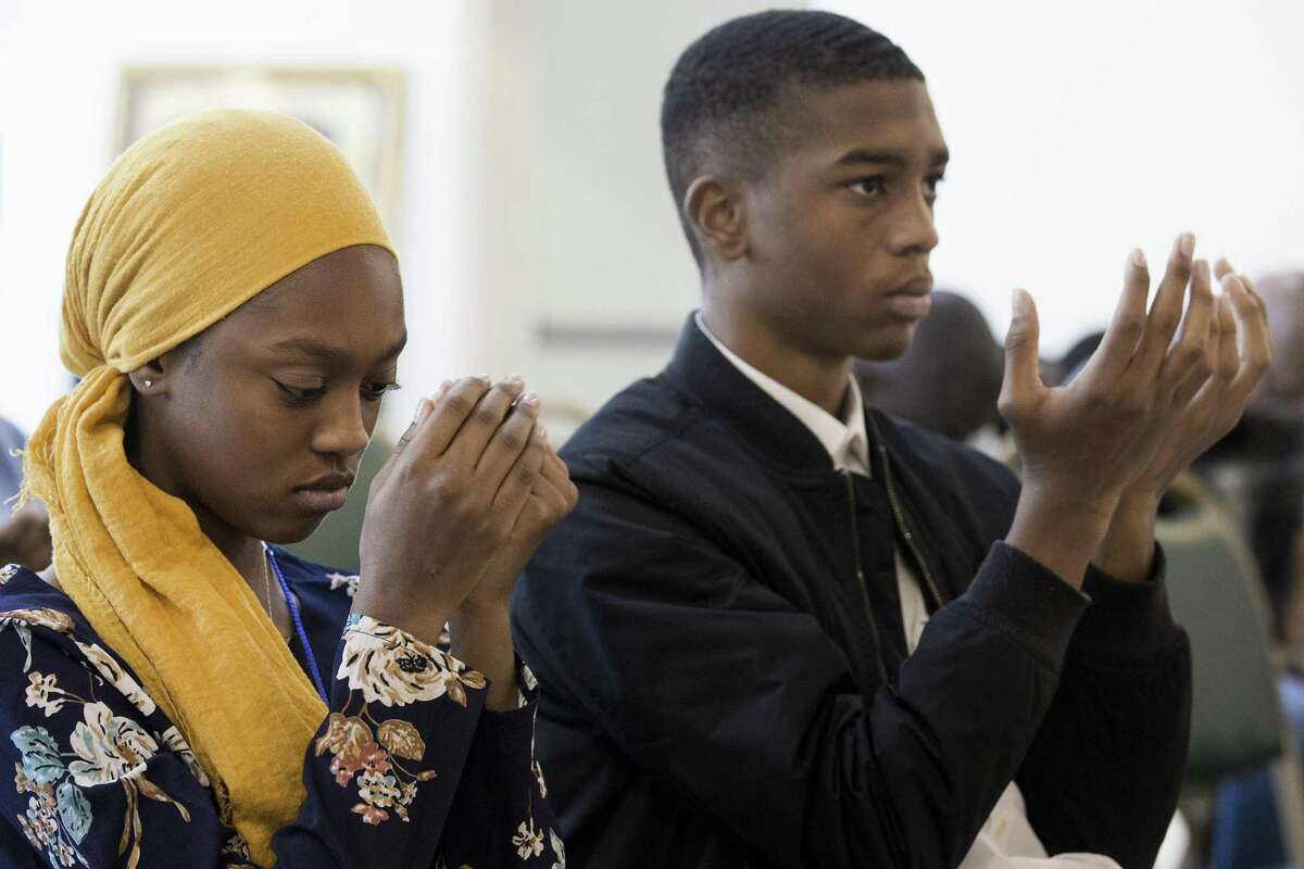 Aaliyah Khalil, 13, left, and her brother, Kamal, 17, perform a day supplication prayer during a service at Houston Masjid of Al-Islam on Sunday, May 5, 2019, in Houston. The Khalil children have been fasting during Ramadan for several years.