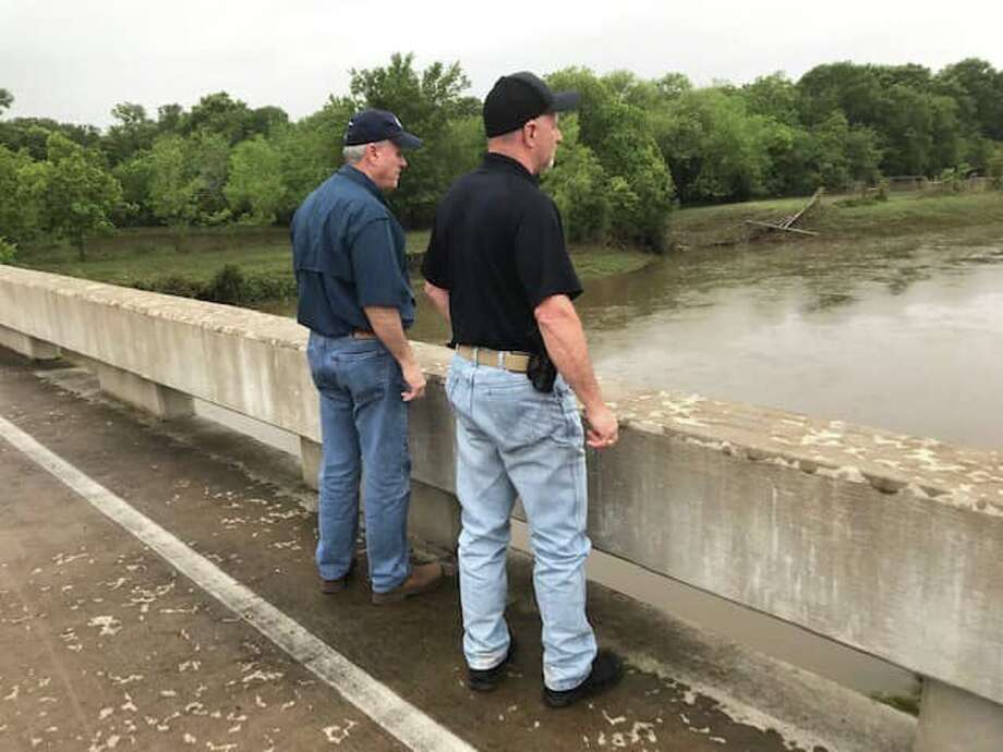 Commissioner Vincent Morales, Constable Mike Beard and Mayor-Elect Andrew Bohac surveyed the damage and high water levels on Saturday, May 11, in the hardest hit parts of Needville. Photo: Fort Bend County Constable Precinct 1