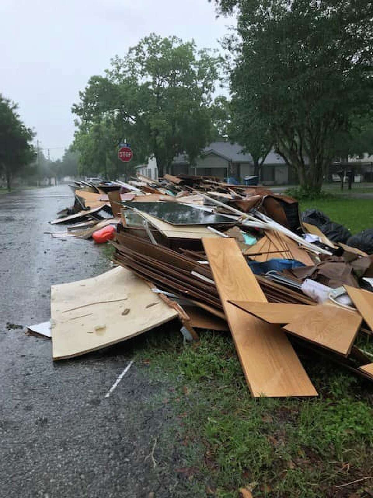 Commissioner Vincent Morales, Constable Mike Beard and Mayor-Elect Andrew Bohac surveyed the damage and high water levels on Saturday, May 11, in the hardest hit parts of Needville.