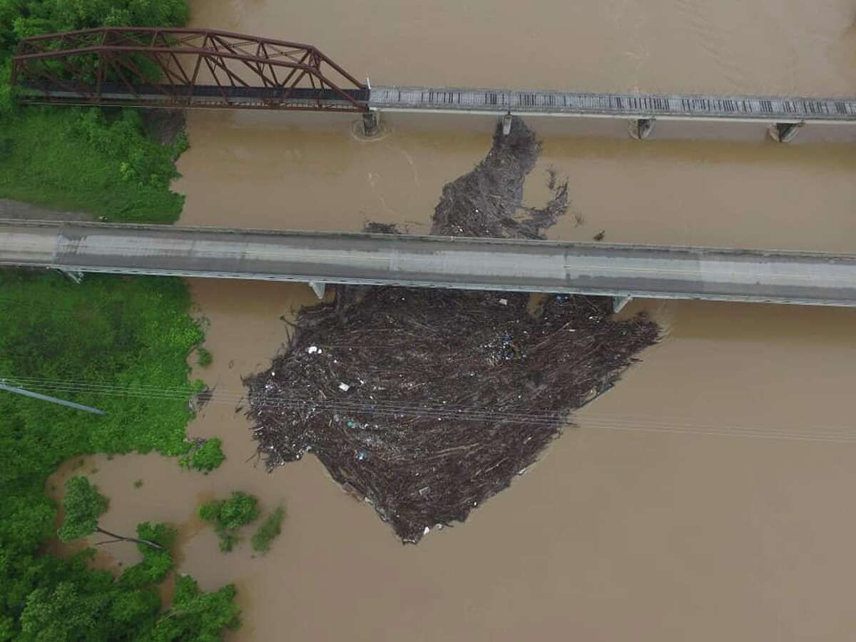 The Fort Bend County Office of Emergency Management released several photos of a logjam at the FM 1093 bridge in Simonton on Saturday, May 11, 2019.