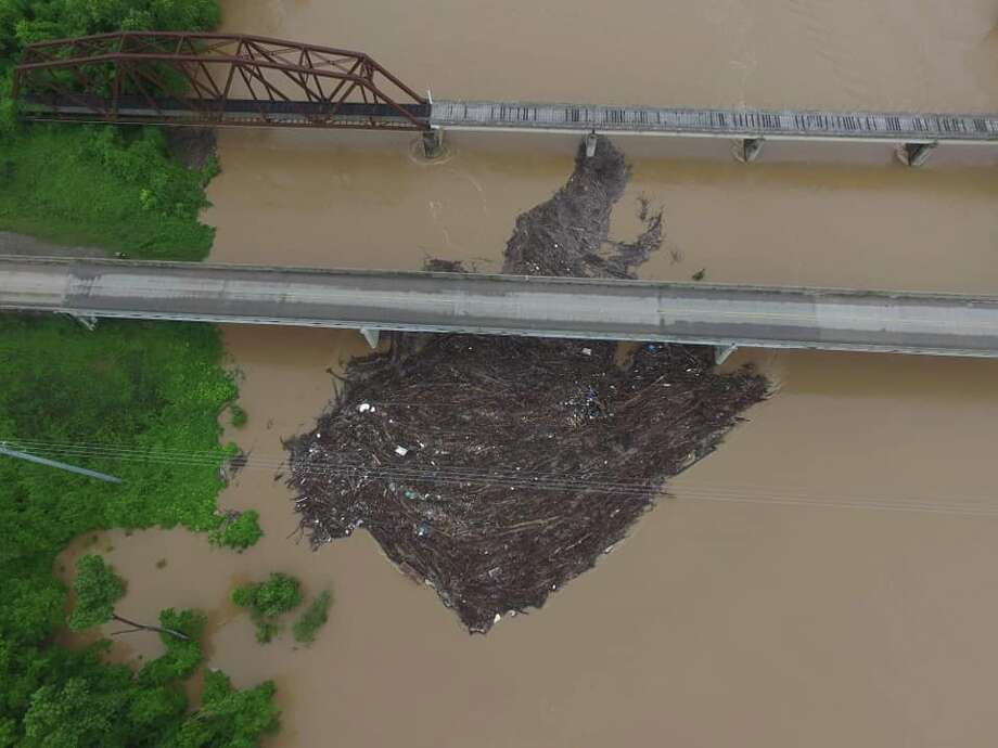 The Fort Bend County Office of Emergency Management released several photos of a logjam at the FM 1093 bridge in Simonton on Saturday, May 11, 2019. Photo: Fort Bend County Office Of Emergency Management