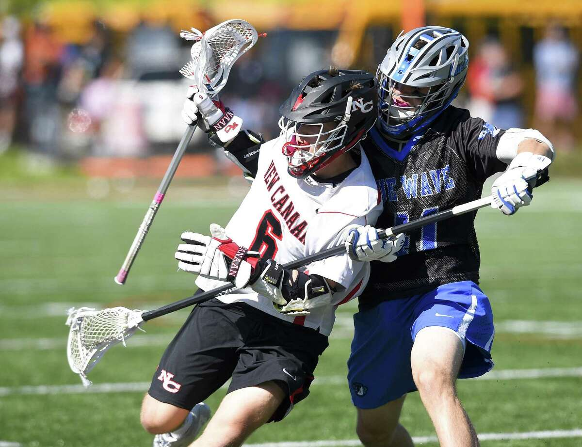 New Canaan's Teddy Manges (6) battles off Darien's Pierce Hoyda (41) in a boys lacrosse game at Duning Field on May 11, 2019 in New Canaan, Connecticut. Darien defeated New Canaan 12-4.