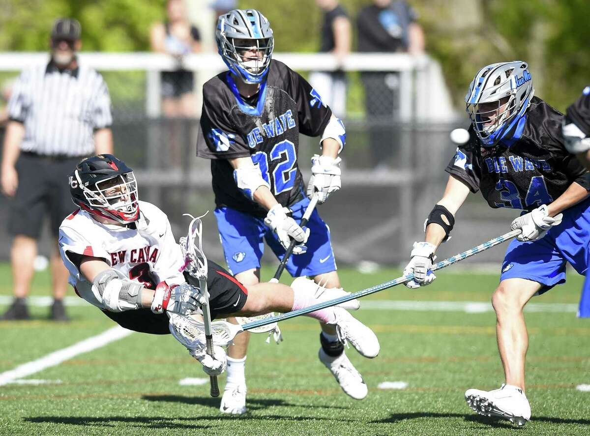 New Canaan's Drew Guida (3) scores against Darien in a boys lacrosse game at Duning Field on May 11, 2019 in New Canaan, Connecticut. Darien defeated New Canaan 12-4.