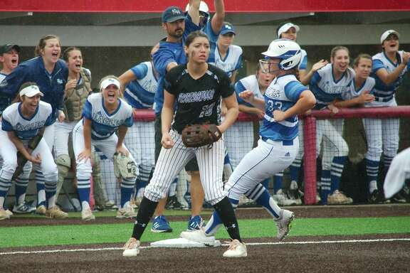 Friendswood's Caylynn Esparza (10) looks for the throw as Barbers Hill's Stephanie Niemann (33) rounds third base Saturday in Crosby. Neimann would drive in the tying and winning runs in a 2-1 Lady Eagle victory.