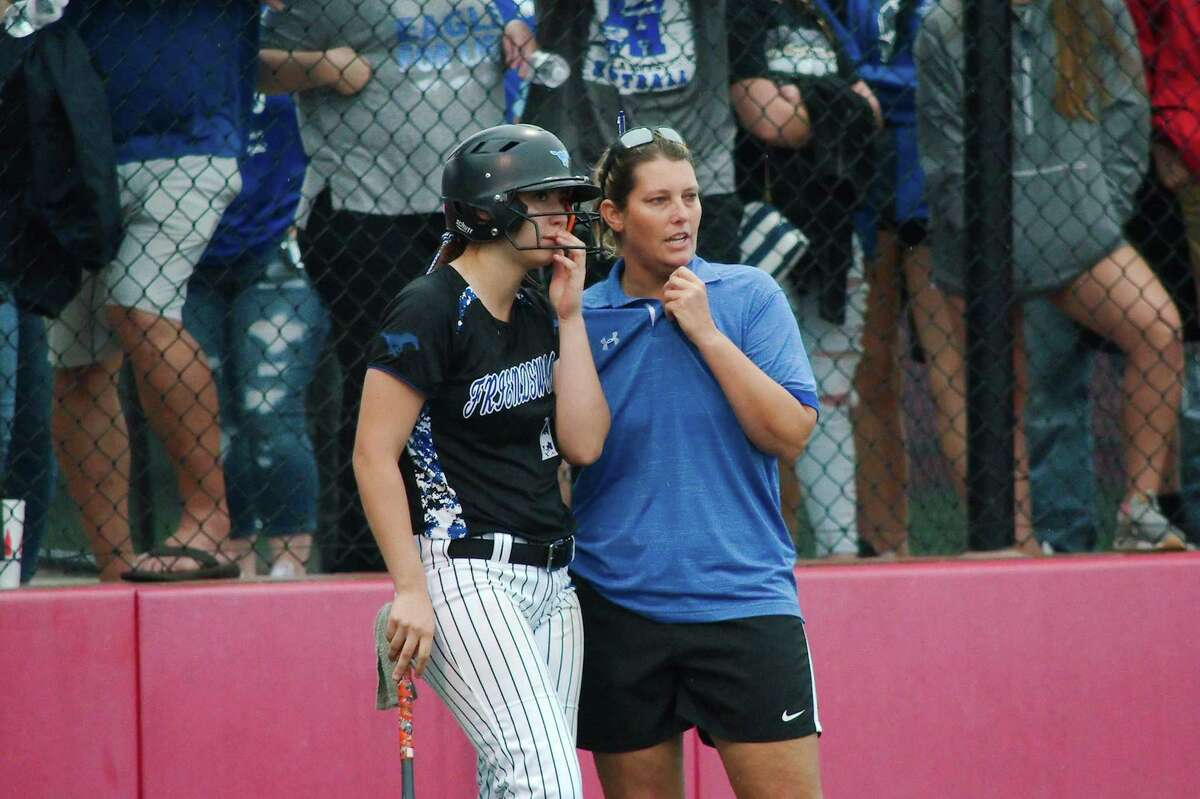 Friendswood's Caylynn Esparza (10) chats with Friendswood coach Christa Williams Saturday in Crosby.
