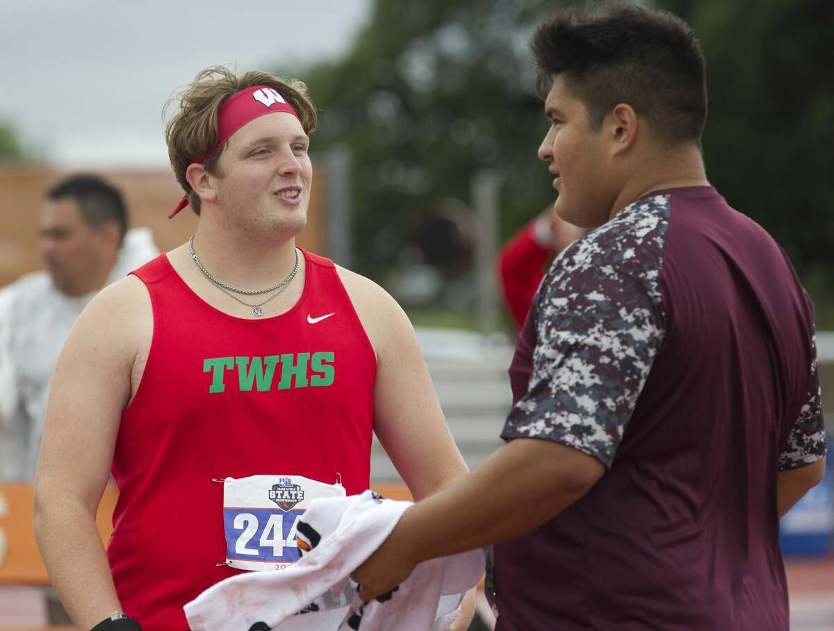 Patrick Piperi of The Woodlands talks with Angel Robles of Summer Creek while competing in the 6A boys shot put during the UIL State Track & Field Championships at Mike A. Myers Stadium, Saturday, May, 11, 2019, in Austin.