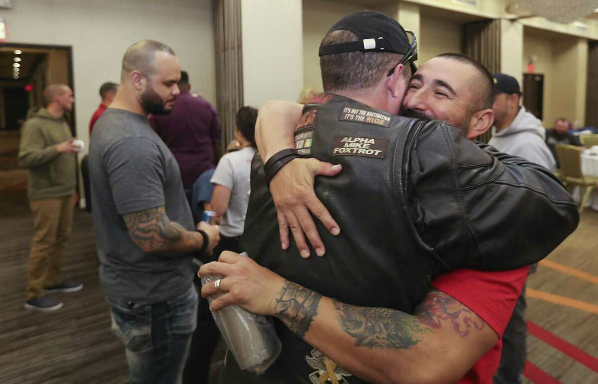 Corp. Brian Nobles hugs Sgt. Danny O'Neel at the Resiliency Resource Fair at the Houston Marriott on May 11, 2019 in Houston, TX. Corp Nobles and Sgt. O'Neel fought under the same company.