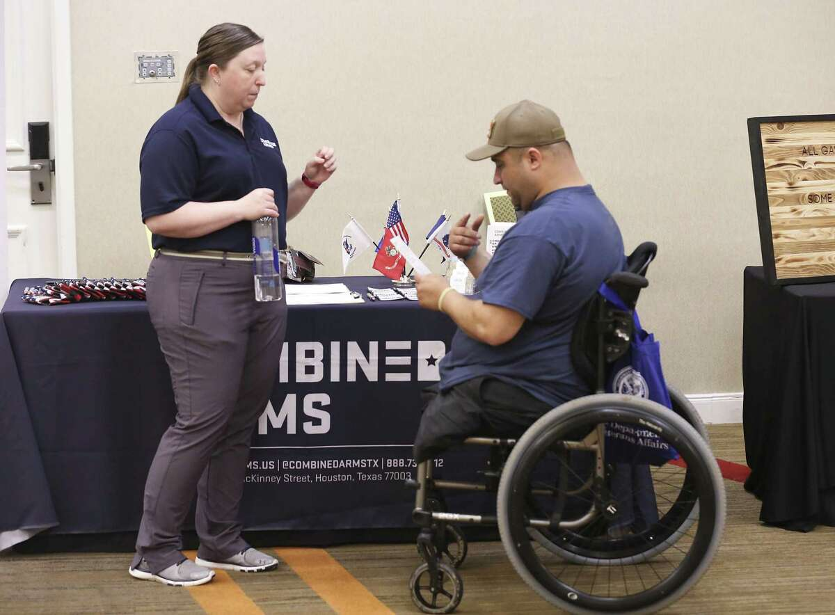 Michelle Cox t, with Combined Arms ,talks with Sgt. Shane Parsons at the Resiliency Resource Fair at the Houston Marriott on May 11, 2019 in Houston, TX.