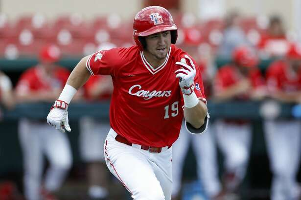 Houston's Jared Triolo (19) runs down the first base line during an UNLV at University of Houston NCAA college baseball game, Sunday, May 5, 2019, in Houston. (AP Photo/Aaron M. Sprecher)