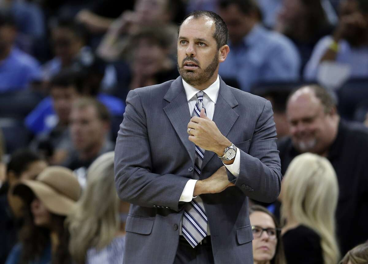 FILE - In this Oct. 24, 2017, file photo, Orlando Magic coach Frank Vogel watches his team play the Brooklyn Nets during the first half of an NBA basketball game in Orlando, Fla. A person familiar with the search says the Los Angeles Lakers have hired Vogel as coach. The person spoke to The Associated Press on condition of anonymity Saturday, May 11, because the hiring has not been announced. Vogel flew to Los Angeles on Thursday. The 45-year old Vogel did not coach last season following two years with the Magic. (AP Photo/John Raoux, File)